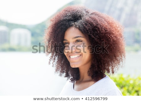 Sideways of cheerful woman Stock photo © stockyimages