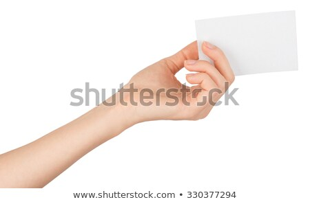 Womans left hand offering small empty card Stock photo © cherezoff