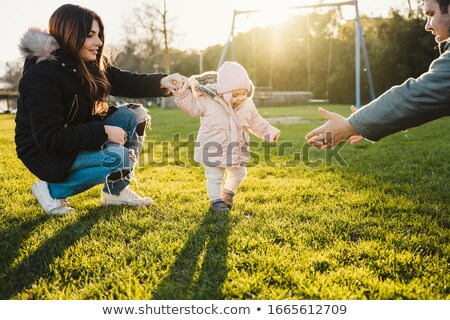 mother and father with the children in the park in autumn stock photo © Paha_L
