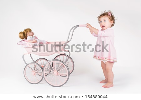 small girl with the doll in the carriage stock photo © Paha_L