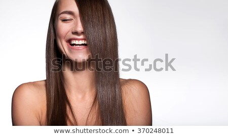 Young woman with straight hair on dark background. Portrait. Stock photo © gromovataya