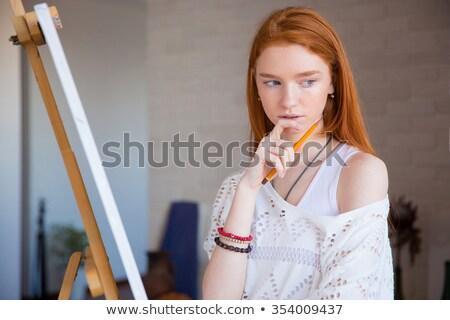 задумчивый Привлекательная женщина художник мышления мольберт рисунок Сток-фото © deandrobot
