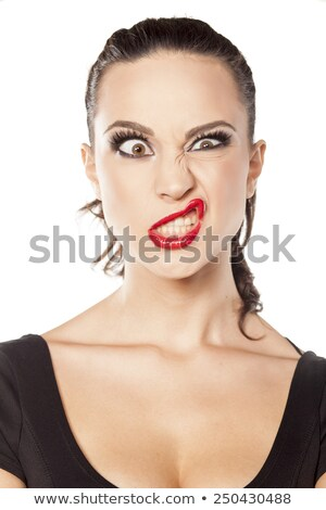Stock fotó: Portrait Of Playful Amusing Young Woman Making Funny Face