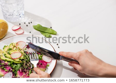 Plate with one pea, glass of water, fork and knife Stock photo © deandrobot