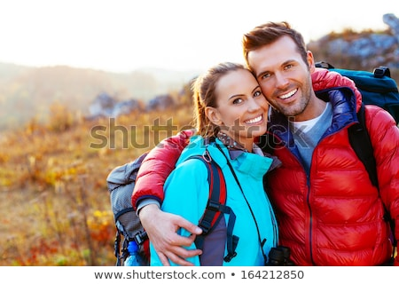 young handsome couple in mountain stock photo © konradbak