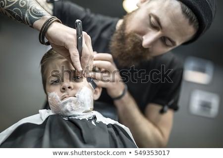 Small boy in barbershop Stock photo © bezikus
