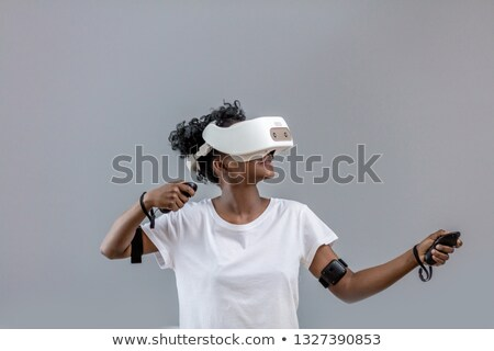 African american girl using VR glasses Stock photo © dash
