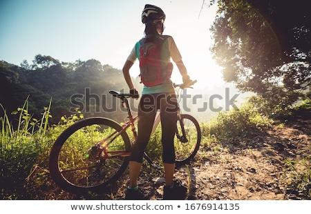 Mulher jovem mountain bike esportes cor ciclismo mountain bike Foto stock © monkey_business