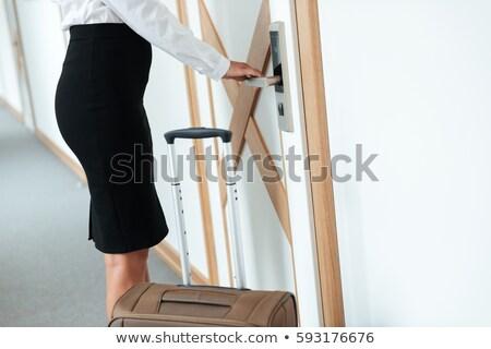 Afbeelding zakenvrouw deur behandelen Stockfoto © deandrobot