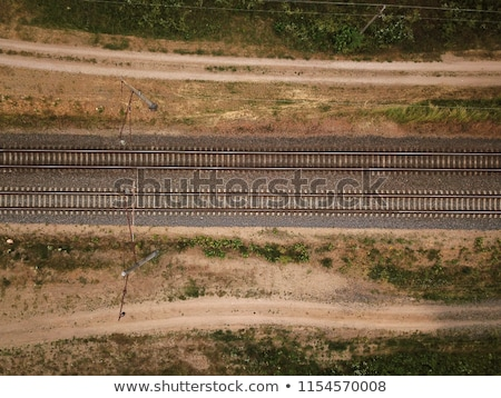 aerial view of railway track through countryside drone top view stock photo © stevanovicigor