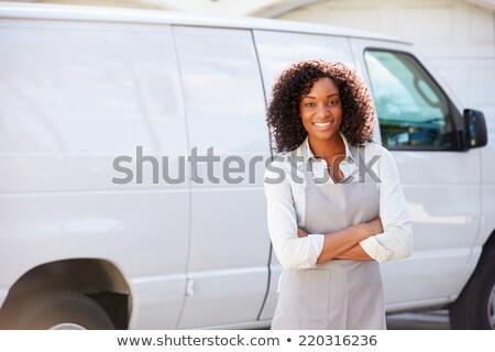 Portrait of happy woman standing by van Stock photo © wavebreak_media