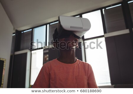 low angle view of boy wearing virtual reality simulator stock photo © wavebreak_media