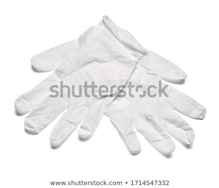Blue rubber gloves on white background Stock photo © wavebreak_media