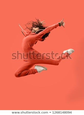 Portrait of young woman in mid air gesturing Stock photo © julenochek