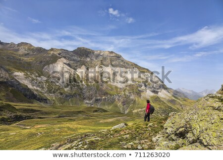 hiker in the circus of troumouse   pyrenees mountains stock photo © razvanphotography