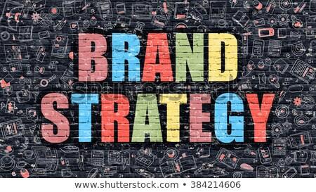 Marke Strategie dunkel Backsteinmauer Doodle Symbole Stock foto © tashatuvango