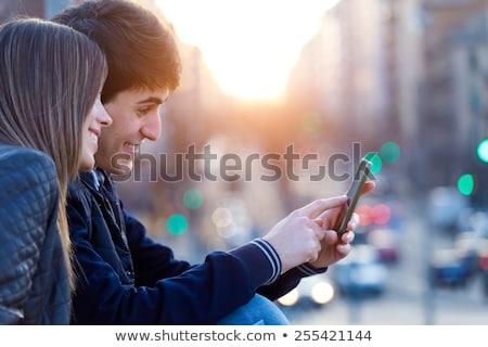 alegre · menino · telefone · móvel · mochila · de · volta · à · escola - foto stock © 2Design