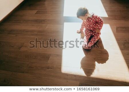 Cute девочку пижама сидят домой Сток-фото © deandrobot