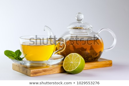 vidrio · tetera · té · limón · flor · medicina - foto stock © janpietruszka