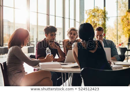 Group of young people in a library Stock photo © IS2