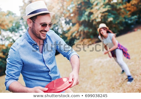Stock photo: Couple playing frisbee
