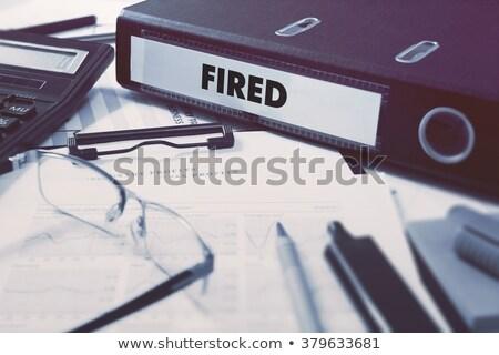 Fired on Binder. Blurred Image. Stock photo © tashatuvango