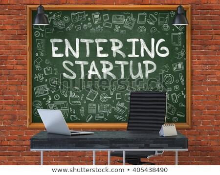 hand drawn entering startup on office chalkboard stock photo © tashatuvango