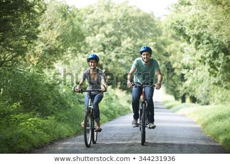 Uomo ciclismo paese corsia donna strada Foto d'archivio © IS2