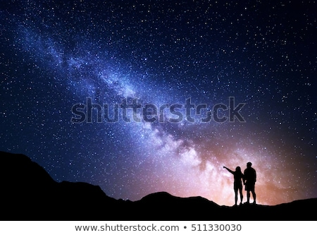 Milky Way and silhouette of happy woman. Space Stock photo © denbelitsky