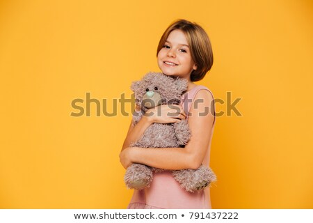 Joli belle fille hug peluche ours souriant Photo stock © deandrobot