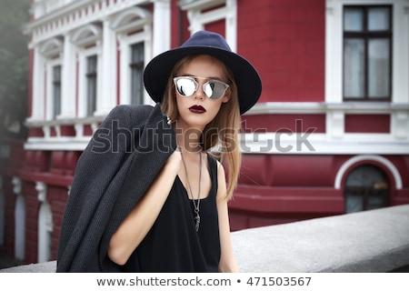 fashion style photo of a gorgeous women stock photo © konradbak
