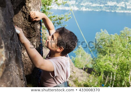 Children climbing on rocks by lake Stock photo © IS2