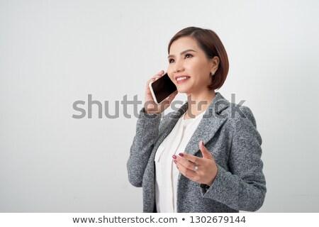 Asian businesswoman talking on phone stock photo © studioworkstock