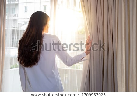 Back view portrait of a young attractive girl Stock photo © deandrobot