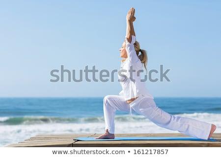 старший женщину йога пляж песок женщины Сток-фото © IS2