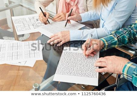Idős keresztrejtvény puzzle könyv nők életstílus Stock fotó © FreeProd