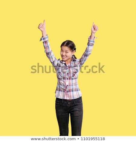 Asian girl shows well done with both hands Stock photo © leedsn