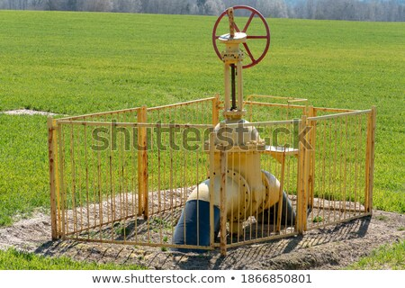 Gas pipeline yellow pipe and large gas faucet Stock photo © orensila
