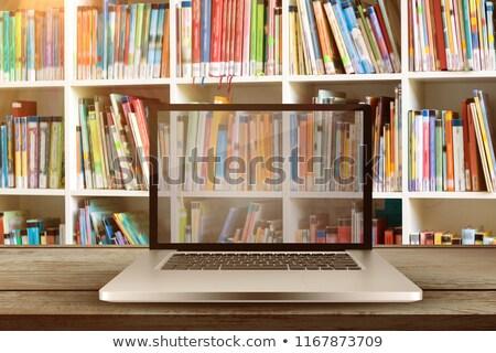 Surface of wooden plank against library shelf stock photo © wavebreak_media