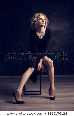 Férfi ül szék nő divat fekete Stock fotó © wavebreak_media