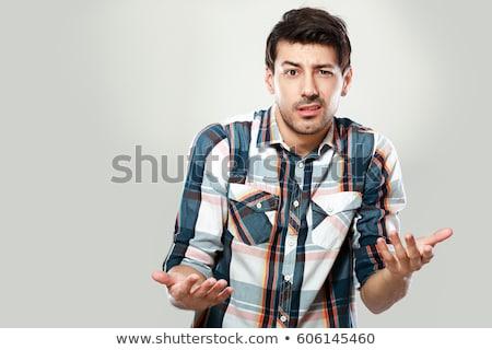 Verward jonge man schouders permanente tabel praten Stockfoto © deandrobot