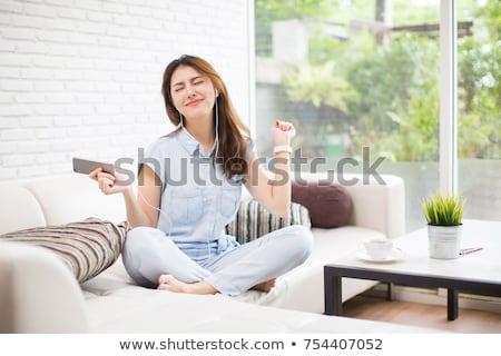 Boldog ázsiai nő fülhallgató hallgat zene Stock fotó © dolgachov