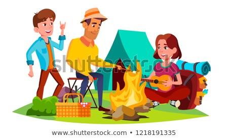 Gençler oturma etrafında kamp ateşi eğlence vektör Stok fotoğraf © pikepicture