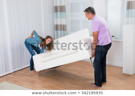 Homem sofrimento dor nas costas sofá vista lateral Foto stock © AndreyPopov