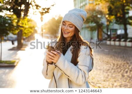 счастливым красивой женщину ходьбе улице Сток-фото © deandrobot
