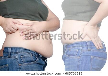 Women shows her weight loss. Stock photo © ruslanshramko