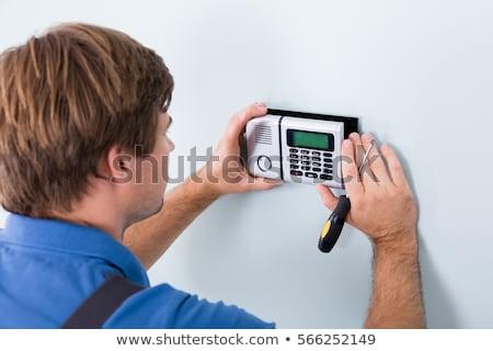 technikus · megjavít · biztonság · ajtó · szenzor · közelkép - stock fotó © andreypopov