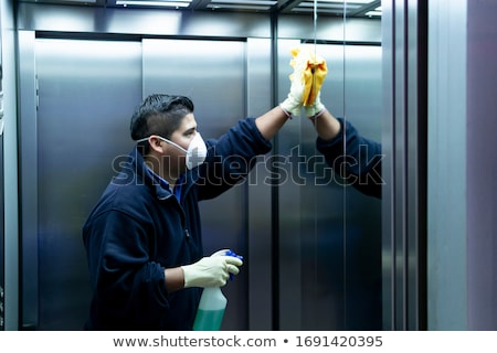 Janitor Cleaning Elevator Stock photo © AndreyPopov