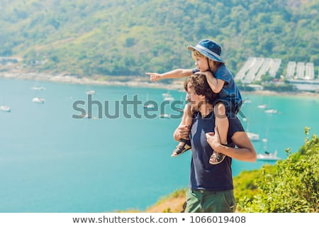 Father and son in the background of Promthep cape and Yanui beach. Phuket, Thailand. Traveling with  Stock photo © galitskaya