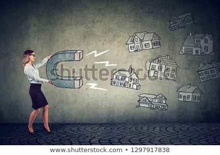 Businesswoman with a magnet attracting house buyers and household votes Stock photo © ichiosea